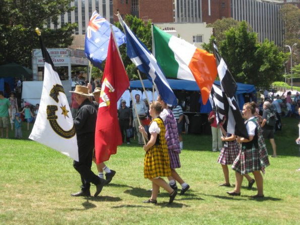 Celtic groups parade with their flags